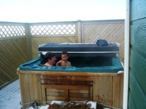 "Amani and I in the outdoor volcanically heated jacuzzi (aka hotpot) (Is it ""icy"" in Iceland?)"