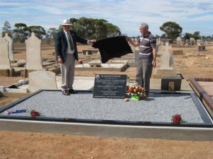 Rex and Kevin Kakoschke formally unveil the headstone