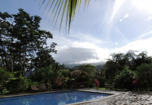 Look carefully, you can just make out Arenal Volcano